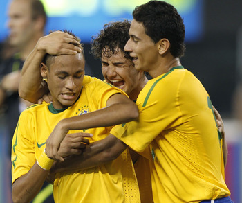 EAST RUTHERFORD, NJ - AUGUST 10:  Neymar #11, Paulo Henrique Ganso #10 and Alexandre Pato #9 of Brazil celebrate Neymar's goal against the U.S. in the first half of a friendly match at the New Meadowlands on August 10, 2010 in East Rutherford, New Jersey.