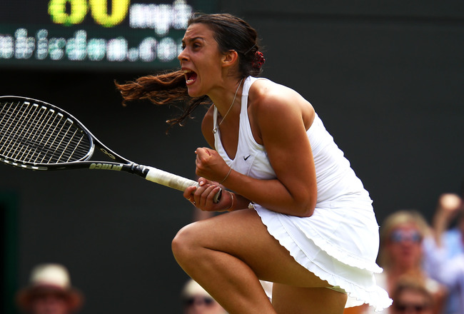 LONDON, ENGLAND - JUNE 27:  Marion Bartoli of France celebrates after winning her fourth round match against Serena Williams of the United States on Day Seven of the Wimbledon Lawn Tennis Championships at the All England Lawn Tennis and Croquet Club on Ju