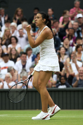 LONDON, ENGLAND - JUNE 28:  Marion Bartoli of France reacts to a play during her quarterfinal round match against Sabine Lisicki of Germany on Day Eight of the Wimbledon Lawn Tennis Championships at the All England Lawn Tennis and Croquet Club on June 28,