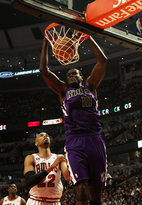 CHICAGO, IL - MARCH 21: Samuel Dalembert #10 of the Sacramento Kings dunks the ball over Taj Gibson #22 of the Chicago Bulls at the United Center on March 21, 2011 in Chicago, Illinois. The Bulls defeated the Kings 132-92. NOTE TO USER: User expressly ack