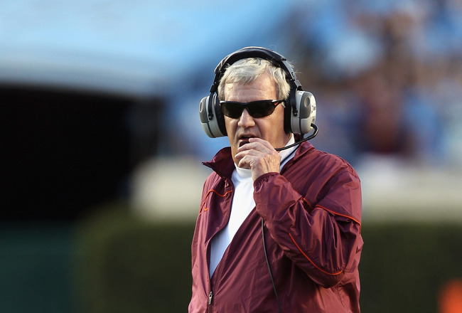 CHAPEL HILL, NC - NOVEMBER 13:  Head coach Frank Beamer of the Virginia Tech Hokies walk onto the field against the North Carolina Tar Heels during their game at Kenan Stadium on November 13, 2010 in Chapel Hill, North Carolina.  (Photo by Streeter Lecka/