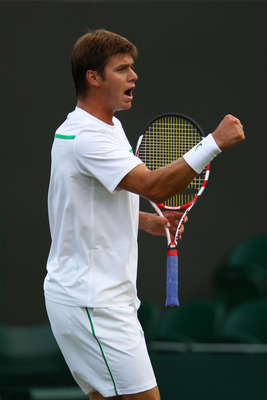 LONDON, ENGLAND - JUNE 23:  Ryan Harrison of the United States reacts to a play during his second round match  David Ferrer of Spain on Day Four of the Wimbledon Lawn Tennis Championships at the All England Lawn Tennis and Croquet Club on June 23, 2011 in