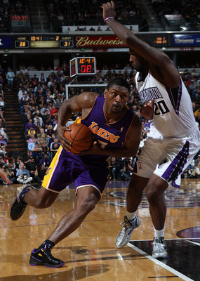SACRAMENTO, CA - APRIL 13:  Ron Artest #15 of the Los Angeles Lakers drives against Donte Greene #20 of the Sacramento Kings on April 13, 2011 at Power Balence Pavilion in Sacramento, California. NOTE TO USER: User expressly acknowledges and agrees that,