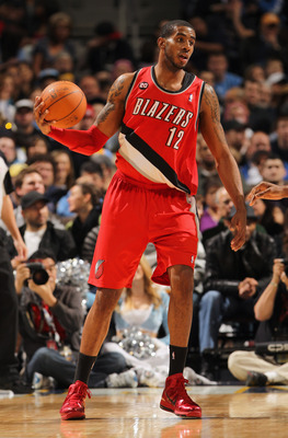 DENVER - DECEMBER 28:  LaMarcus Aldridge #12 of the Portland Trail Blazers controls the ball against the Denver Nuggets at Pepsi Center on December 28, 2010 in Denver, Colorado. The Nuggets defeated the Blazers 95-77. NOTE TO USER: User expressly acknowle