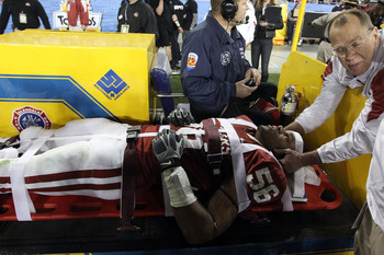 GLENDALE, AZ - JANUARY 01:  Ronnell Lewis #56 of the Oklahoma Sooners is taken off the sideline on a stretcher after an injury while taking on the Connecticut Huskies during the Tostitos Fiesta Bowl at the Universtity of Phoenix Stadium on January 1, 2011