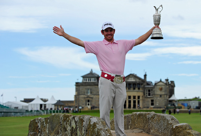 ST ANDREWS, SCOTLAND - JULY 19:  2010 Open Champion Louis Oosthuizen of South Africa poses with the Claret Jug on the Swilken bridge on July 19, 2010 in St Andrews, Scotland.  (Photo by Stuart Franklin/Getty Images)