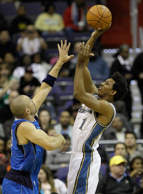 WASHINGTON, DC - FEBRUARY 26: Nick Young #1 of the Washington Wizards shoots over Jason Kidd #2 of the Dallas Mavericks at the Verizon Center on February 26, 2011 in Washington, DC. NOTE TO USER: User expressly acknowledges and agrees that, by downloading