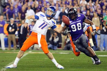 GLENDALE, AZ - JANUARY 04:  Quarterback Kellen Moore #11 of the Boise State Broncos passes the ball in the second half as Jerry Hughes #98 of the TCU Horned Frogs rushes in during the Tostitos Fiesta Bowl at the Universtity of Phoenix Stadium on January 4