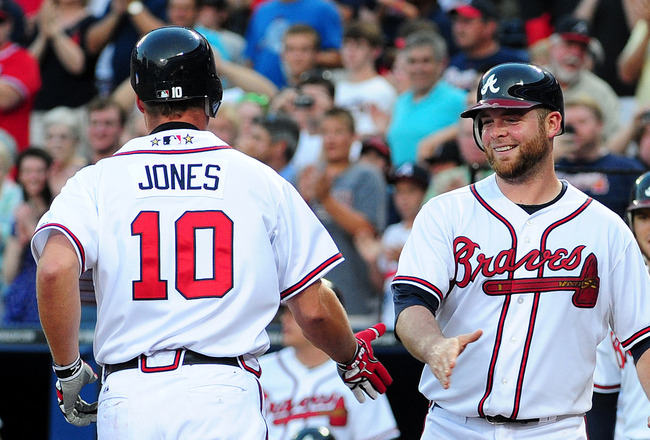ATLANTA - JULY 6: Chipper Jones #10 of the Atlanta Braves is congratulated by Brian McCann #16 after hitting a 3rd inning home run against the Colorado Rockies at Turner Field on July 6, 2011 in Atlanta, Georgia. (Photo by Scott Cunningham/Getty Images)