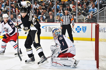 PITTSBURGH, PA - FEBRUARY 8:  Eric Tangradi #26 of the Pittsburgh Penguins sets up in front of goaltender Steve Mason #1 of the Columbus Blue Jackets on February 8, 2011 at CONSOL Energy Center in Pittsburgh, Pennsylvania.  (Photo by Jamie Sabau/Getty Ima