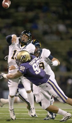 SEATTLE - DECEMBER 05: Quarterback Kevin Riley #13 of the California Bears is sacked by Everrette Thompson #92 of the Washington Huskies on December 5, 2009 at Husky Stadium in Seattle, Washington. The Huskies defeated the Bears 42-10. (Photo by Otto Greu