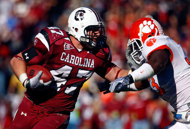 COLUMBIA, SC - NOVEMBER 28:  Patrick DiMarco #47 of the South Carolina Gamecocks fights off the tackle of Kavell Conner #33 of the Clemson Tigers at Williams-Brice Stadium on November 28, 2009 in Columbia, South Carolina.  (Photo by Scott Halleran/Getty I