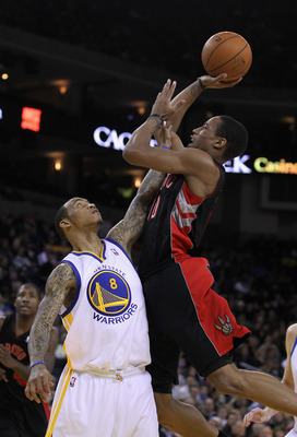 OAKLAND, CA - MARCH 25: DeMar DeRozan #10 of the Toronto Raptors shoots over Monta Ellis #8 of the Golden State Warriors at Oracle Arena on March 25, 2011 in Oakland, California. NOTE TO USER: User expressly acknowledges and agrees that, by downloading an