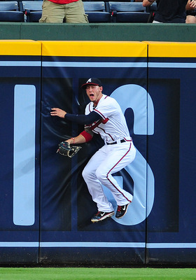 ATLANTA - JULY 2: Jordan Schafer #1 of the Atlanta Braves makes a catch against the Baltimore Orioles at Turner Field on July 2, 2011 in Atlanta, Georgia. (Photo by Scott Cunningham/Getty Images)