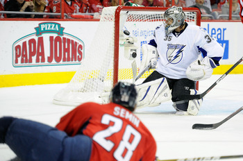 WASHINGTON, DC - APRIL 29:  Dwayne Roloson #35 of the Tampa Bay Lightning make a save after Alexander Semin #28  of the Washington Capitals hits the post during Game One of the Eastern Conference Semifinal during the 2011 NHL Stanley Cup Finals at the Ver