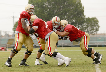 SANTA CLARA, CA - AUGUST 02:  Joe Staley #74 and Mike Iupati #77 work out during the San Francisco 49ers training camp at their training complex on August 2, 2010 in Santa Clara, California.  (Photo by Ezra Shaw/Getty Images)