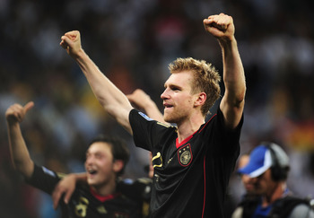 CAPE TOWN, SOUTH AFRICA - JULY 03:  Per Mertesacker of Germany celebrates victory following the 2010 FIFA World Cup South Africa Quarter Final match between Argentina and Germany at Green Point Stadium on July 3, 2010 in Cape Town, South Africa.  (Photo b