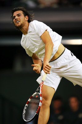 LONDON, ENGLAND - JUNE 23:  Adrian Mannarino of France serves during his second round match against Roger Federer of Switzerland on Day Four of the Wimbledon Lawn Tennis Championships at the All England Lawn Tennis and Croquet Club on June 23, 2011 in Lon