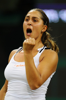 LONDON, ENGLAND - JUNE 28:  Tamira Paszek of Austria reacts to a play during her quarterfinal round match against Victoria Azarenka of Belarus on Day Eight of the Wimbledon Lawn Tennis Championships at the All England Lawn Tennis and Croquet Club on June