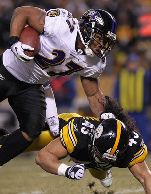 PITTSBURGH, PA - JANUARY 15:  Running back Ray Rice #27 of the Baltimore Ravens runs with the ball after being hit by safety Troy Polamalu #43 of the Pittsburgh Steelers in the AFC Divisional Playoff Game at Heinz Field on January 15, 2011 in Pittsburgh,