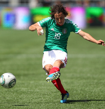 SEATTLE, WA - MAY 28:  Andres Guardado #18 of Mexico shoots against Ecuador at Qwest Field on May 28, 2011 in Seattle, Washington. Mexico and Ecuador played to a 1-1 tie. (Photo by Otto Greule Jr/Getty Images)