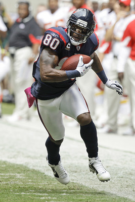 HOUSTON - OCTOBER 17:  Andre Johnson #80 of the Houston Texans runs with the ball during game action against the Kansas City Chiefs at Reliant Stadium on October 17, 2010 in Houston, Texas.  (Photo by Bob Levey/Getty Images)