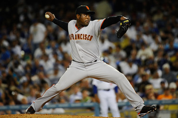 LOS ANGELES, CA - MARCH 31:  Santiago Casilla #46 of the San Francisco Giants throws a pitch against the Los Angeles Dodgers in the eighth inning of Opening Day at Dodger Stadium on March 31, 2011 in Los Angeles, California.  (Photo by Kevork Djansezian/G