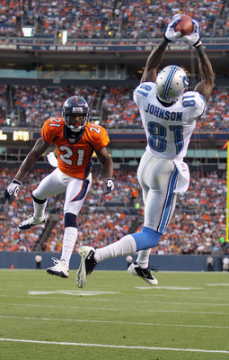 DENVER - AUGUST 21:  Calvin Johnson  #81 of the Detroit Lions makes a 20 yard touchdown catch as Andre Goodman #21 of the Denver Broncos defends  during preseason NFL action at INVESCO Field at Mile High on August 21, 2010 in Denver, Colorado. The touchdo