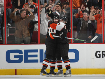 Upshall celebrates with Hartnell after a goal