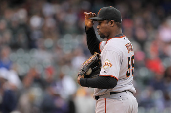DENVER, CO - APRIL 20:  Relief pitcher Guillermo Mota #59 of the San Francisco Giants delivers against the Colorado Rockies at Coors Field on April 20, 2011 in Denver, Colorado.  (Photo by Doug Pensinger/Getty Images)