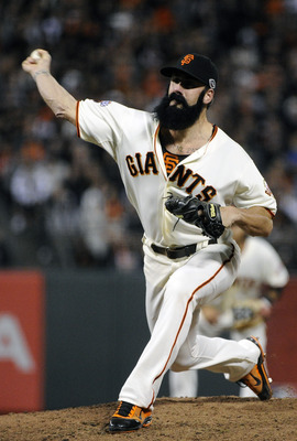 SAN FRANCISCO, CA - JULY 6: Brian Wilson #38 of the San Francisco Giants pitches against the San Diego Padres in the ninth inning during an MLB baseball game at AT&amp;T Park July 6, 2011 in San Francisco, California. (Photo by Thearon W. Henderson/Getty Imag