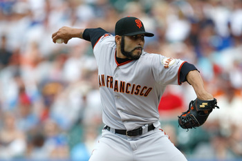 CHICAGO, IL - JUNE 30: Sergio Romo #54 of the San Francisco Giants pitches against the Chicago Cubs at Wrigley Field on June 30, 2011 in Chicago, Illinois. (Photo by Scott Boehm/Getty Images)