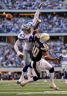 ARLINGTON, TX - DECEMBER 13:  Wide receiver Malcom Floyd #80 of the San Diego Chargers get a pass interference call against Gerald Sensabaugh #43 of the Dallas Cowboys at Cowboys Stadium on December 13, 2009 in Arlington, Texas.  (Photo by Ronald Martinez