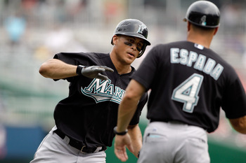 WASHINGTON, DC - JULY 28: Mike Stanton #27 (L) of the Florida Marlins is congratulated by third base coach Joe Espada #4 after hitting a solo home run against the Washington Nationals during the sixth inning at Nationals Park on July 28, 2011 in Washingto