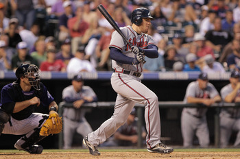 DENVER, CO - JULY 18:  Freddie Freeman #5 of the Atlanta Braves hits into a force out that scored Derek Lowe #32 of the Atlanta Braves to give the Braves a 7-1 lead over the Colorado Rockies in the sixth inning at Coors Field on July 18, 2011 in Denver, C