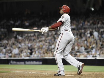 SAN DIEGO, CA - JULY 27: Justin Upton #10 of the Arizona Diamondbacks watches the flight of  a solo home run hit during the sixth inning of a baseball game against the San Diego Padres at Petco Park on July 27, 2011 in San Diego, California.  (Photo by De