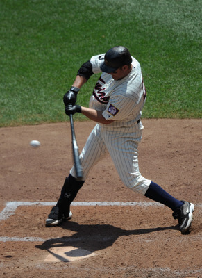 MINNEAPOLIS, MN - JULY 6: Jim Thome #25 of the Minnesota Twins hits a two RBI single against the Tampa Bay Rays in the fifth inning on July 6, 2011 at Target Field in Minneapolis, Minnesota. The Rays defeated the Twins 12-5. (Photo by Hannah Foslien/Getty