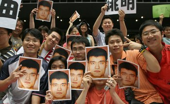 SAITAMA, JAPAN - AUGUST 27:  Chinese supporters displaying pictures of China's star player Yao Ming during the Eight Finals round of the 2006 FIBA World Championships on August 27, 2006 at the Saitama Super Arena in Saitama, Japan.  (Photo by Koichi Kamos