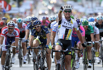 CHATEAUROUX, FRANCE - JULY 08:  Mark Cavendish of Great Britain and HTC Highroad celebrates as he crosses the finish line to win stage seven of the 2011 Tour de France from Le Mans to Chateauroux on July 8, 2011 in Chateauroux, France.  (Photo by Bryn Len