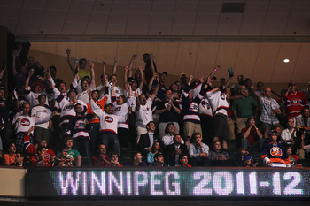 ST PAUL, MN - JUNE 24:  Fans of the Winnipeg Jets cheer on during day one of the 2011 NHL Entry Draft at Xcel Energy Center on June 24, 2011 in St Paul, Minnesota.  (Photo by Bruce Bennett/Getty Images)