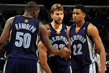 NEW ORLEANS - MARCH 03:  Zach Randolph #50, Mike Conley #11, Marc Gasol #33 congratulate Rudy Gay #22 of the Memphis Grizzlies after picking up a loose ball against the New Orleans Hornets at the New Orleans Arena on March 3, 2010 in New Orleans, Louisian