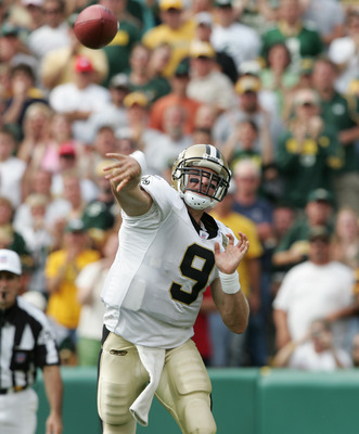 GREEN BAY, WI - SEPTEMBER 17:  Quarterback Drew Brees #9 of the New Orleans Saints passes during the game against the Green Bay Packers on September 17, 2006 at Lambeau Field in Green Bay, Wisconsin. The Saints defeated the Packers 34-27.  (Photo by Elsa/