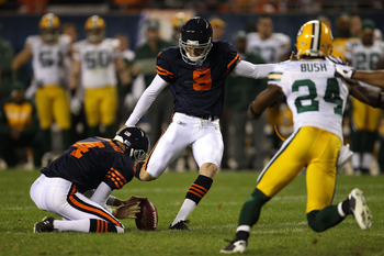CHICAGO - SEPTEMBER 27:  Robbie Gould #9 of the Chicago Bears kicks a successful 25-yard field goal to tie the game 17-17 in the fourth quarter against the Green Bay Packers at Soldier Field on September 27, 2010 in Chicago, Illinois.  (Photo by Jonathan