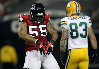 ATLANTA, GA - JANUARY 15:  John Abraham #55 of the Atlanta Falcons celebrates after he sacked Aaron Rodgers #12 of the Green Bay Packers during their 2011 NFC divisional playoff game at Georgia Dome on January 15, 2011 in Atlanta, Georgia.  (Photo by Stre