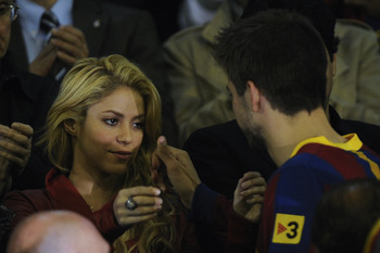 VALENCIA, SPAIN - APRIL 20: Shakira comforts Gerard Pique of Barcelona after beig defeated at the end of the Copa del Rey Final between Real Madrid and Barcelona at Estadio Mestalla on April 20, 2011 in Valencia, Spain.  (Photo by David Ramos/Getty Images
