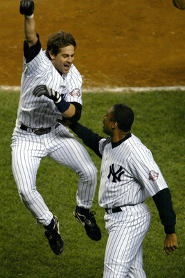 BRONX, NY - OCTOBER 17:  Aaron Boone #19 of the New York Yankees celebrates with Bernie Williams #51 after Boone hit the game winning homerun in the 11th inning off of Tim Wakefield of the Boston Red Sox as the Yankees defeated the Red Sox 6-5 in game sev