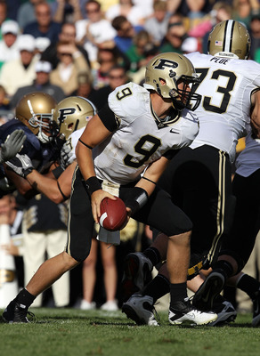 SOUTH BEND, IN - SEPTEMBER 04: Robert Marve #9 of the Purdue Boilermakers tosses the ball to a running back against the Notre Dame Fighting Irish at Notre Dame Stadium on September 4, 2010 in South Bend, Indiana. Notre Dame defated Purdue 23-12.  (Photo b