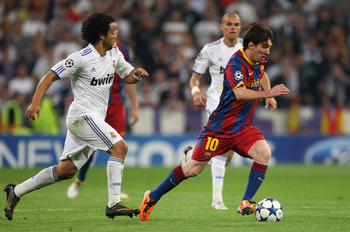 MADRID, SPAIN - APRIL 27:  Lionel Messi of Barcelona beats Marcelo of Real Madrid during the UEFA Champions League Semi Final first leg match between Real Madrid and Barcelona at Estadio Santiago Bernabeu on April 27, 2011 in Madrid, Spain.  (Photo by Ale