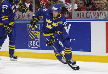 BUFFALO, NY - DECEMBER 31: Defenseman Tim Erixon #4 of Sweden carries the puck during the 2011 IIHF World U20 Championship game between Canada and Sweden on December 31, 2010 at HSBC Arena in Buffalo, New York. (Photo by Tom Szczerbowski/Getty Images)