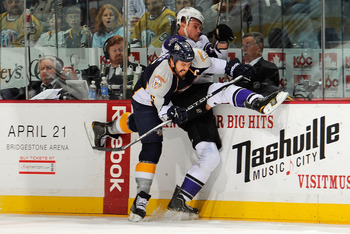 NASHVILLE, TN - MARCH 15:  Shea Weber #6 of the Nashville Predators checks Alexei Ponikarovski #27 of the Los Angeles Kings on March 15, 2011 at the Bridgestone Arena in Nashville, Tennessee.  (Photo by Frederick Breedon/Getty Images)